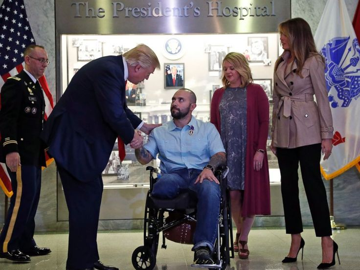 "GEEZers! MrT almost looks human in this one!      PHOTO OF THE DAY: Over the weekend, the president and first lady visited the Walter Reed National Military Medical Center in Bethesda, Maryland. In this photo, President Trump shakes hands with U.S. Army Sgt. First Class Alvaro Barrientos after awarding him the Purple Heart. ""I heard about this and I wanted to do it myself,"" the president said before pinning the Purple Heart on Barrientos. (Alex Brandon/AP Photo)"