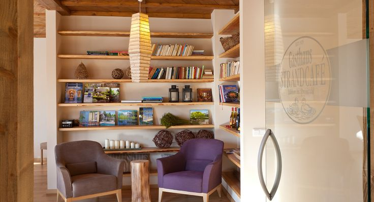 Grab a book in this great library area at sustainable Strandhaus Spreewald in Germany.
