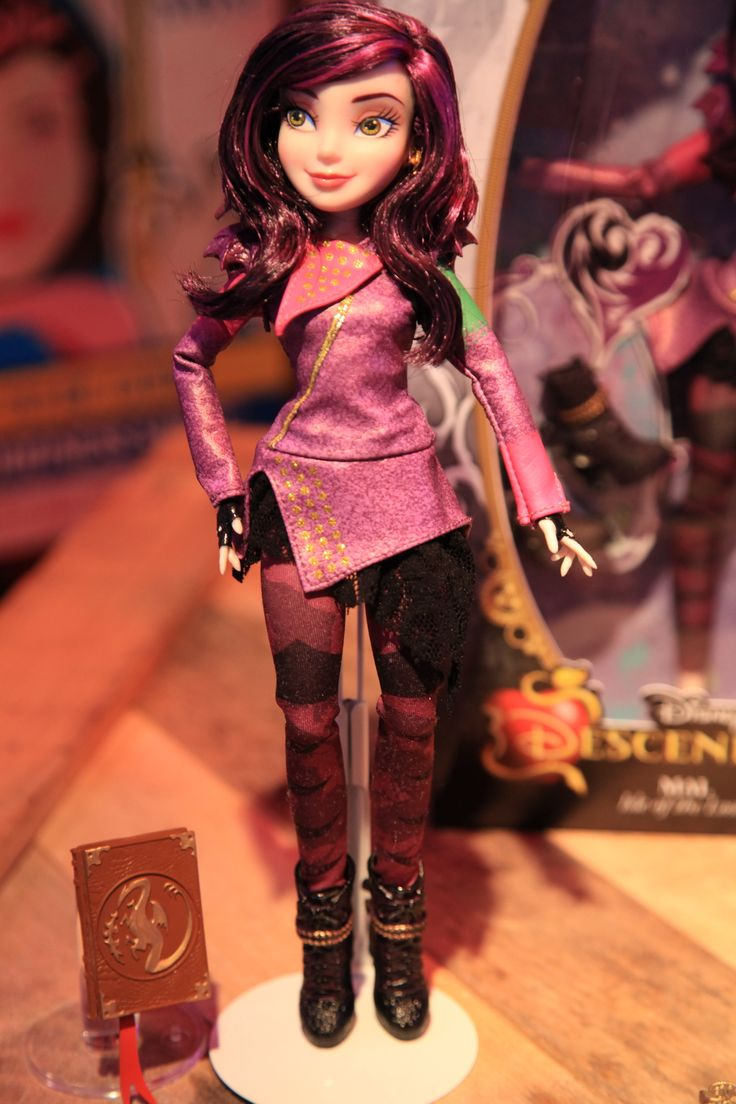 Mal, the daughter of Maleficent, in her signature outfit Disney Descendants doll by Hasbro, 2015 ($23 at DisneyStore.com. I bought her on sale for $17.) - Interestingly, although she is the daughter of Maleficent, she looks more like Raven Queen from Ever After High (as both of their signature colors are purple) than does Evie.