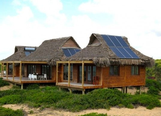 Awe-Inspiring Thatched Mozambique Home is Draped in Solar Panels   Inhabitat - Sustainable Design Innovation, Eco Architecture, Green Building