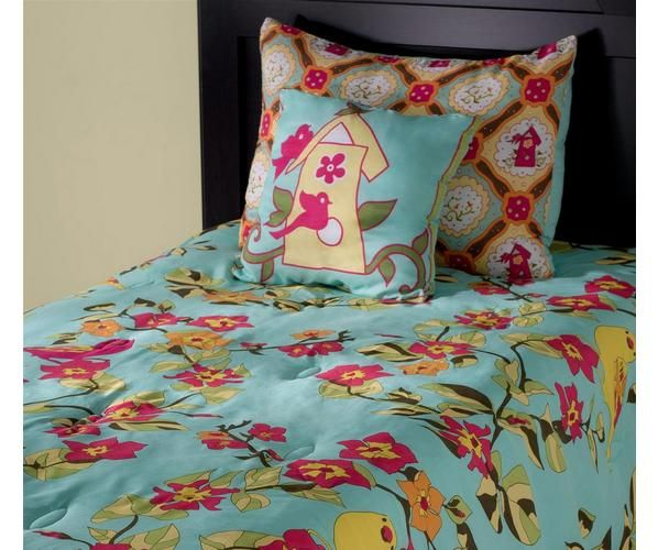 Liven up your kid's bedroom with this tropical comforter set from Laura Fair. The bold, bright colors and playful design transform any bedroom into an island oasis. The set also includes a pillow and shams to complete the ultimate surf's up style.