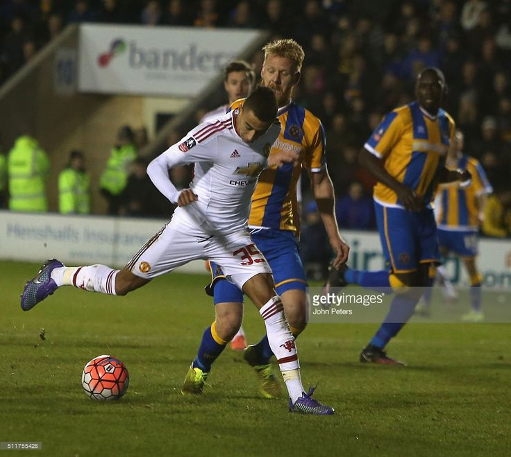 Jesse Lingard of Manchester United in action with Zak Whitbread of Shrewsbury Town during the Emirates FA Cup Fifth Round match between Shrewsbury Town and Manchester United at Greenhous Meadow on February 22, 2016 in Shrewsbury, England.