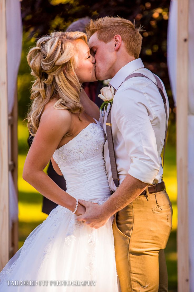 AND YOU MAY KISS THE BRIDE! Bride and Grooms First Kiss at the alter.  What an amazing outdoor country wedding to photograph! http://tailoredfitphotography.com/wedding-photography/zach-evanies-armstrong-country-wedding/