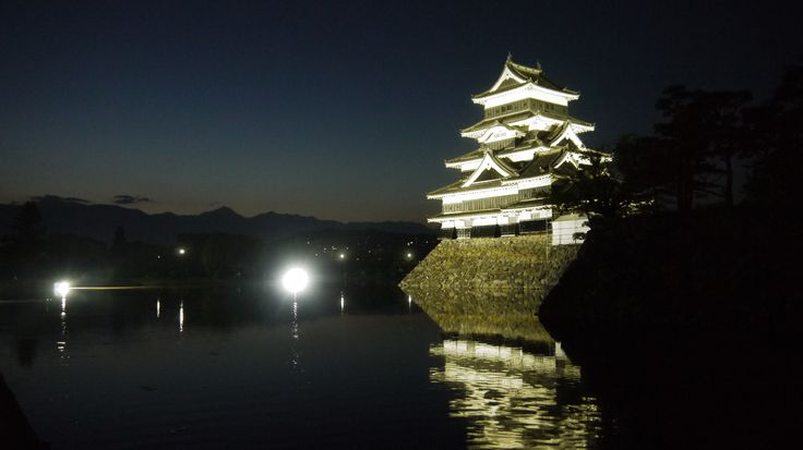 Matsumoto castle and the peaks of the Japan Alps.