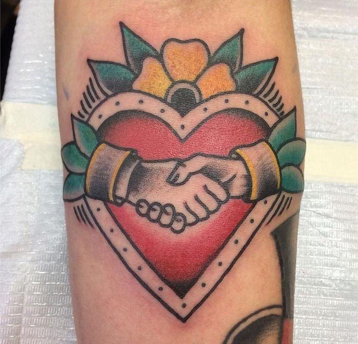 Shaking hands tattoo