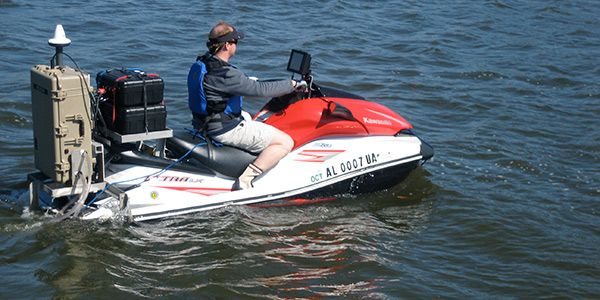Buzzing across Mobile Bay at 40 knots on his red-and-white Kawasaki Ultra LX personal watercraft (PWC), University of South Alabama's Bret Webb isn't just another waterborne thrill seeker looking for a good wake to jump. His PWC is a state-of-the-art research vessel, outfitted for bathymetric surveying, multiparameter water quality sampling and sophisticated water velocity studies in the challenging shallow estuarine environment.