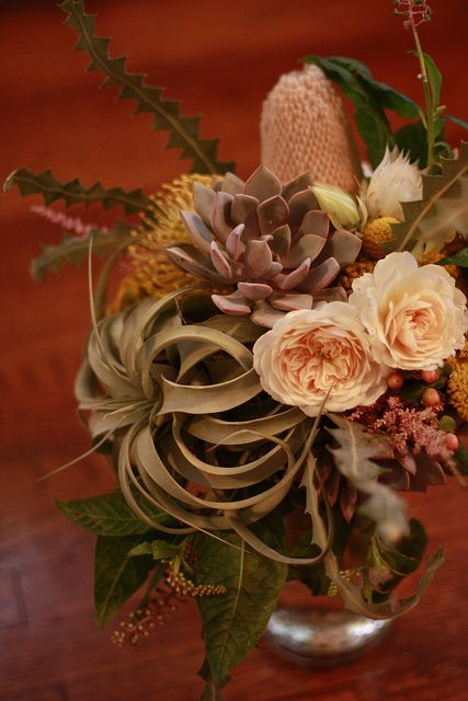I could literally pin every arrangement from Honey and Poppies of Long Beach, California.  This one uses succulents, garden roses and other gorgeous flowers and plants I can't name.  - More Great Ideas from DriedDecor.com