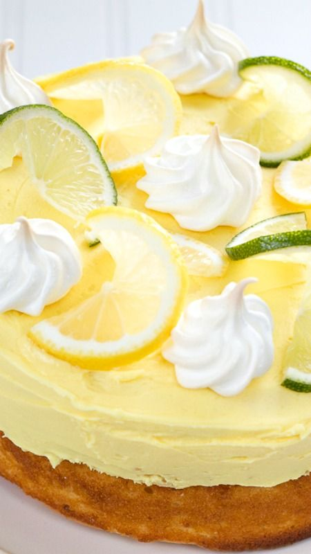 Citrus Surprise Cake ~ the surprise is that the sponge cake conceals a decadent filling of lime curd, meringue and freshly whipped cream. It's a sort of mini lime meringue pie inside!