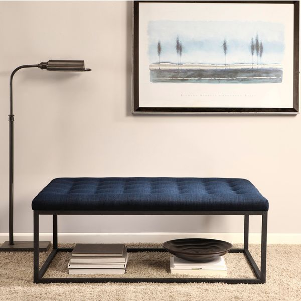 Sleek, modern style and traditional detailing delightfully collide in this stunning linen ottoman from Renate. An angular metal frame sets a minimalist contemporary tone, while the padded and button-t