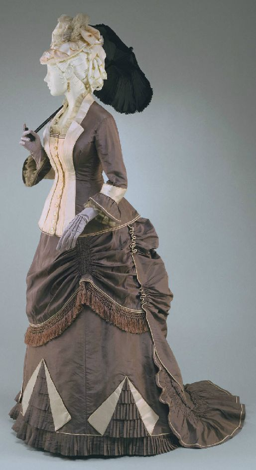 Woman's Dress: Bodice and Skirt Made in United States 1876 Steel grey silk taffeta and pale pink silk plain and striped satin; grey silk knotted fringe and pink satin cording.