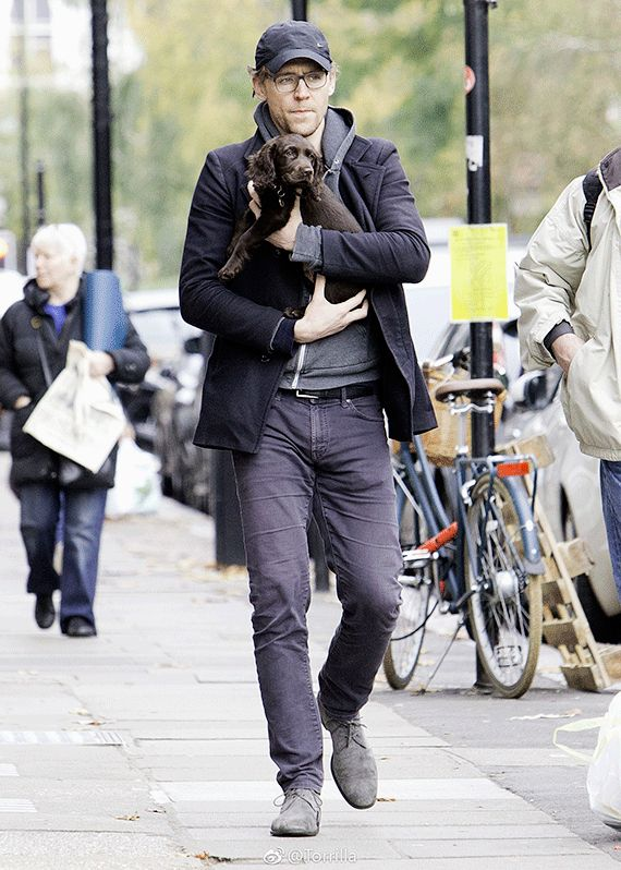 Tom Hiddleston seen cradling a puppy while out on a walk in London on November 9, 2017..so much cuteness in one frame.