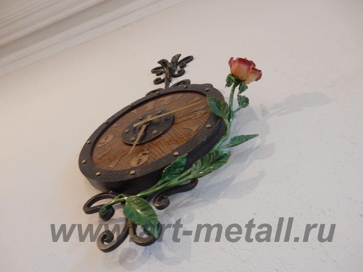 Wrought iron wall clock.