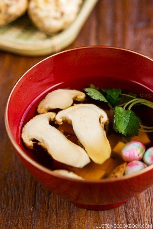 Matsutake Clear Soup (Suimono) is a classic Japanese autumn soup with fresh matsutake mushrooms, tofu, and mitsuba herb in clear dashi broth.   Easy Japanese Recipes at JustOneCookbook.com