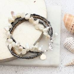 Get an instant boho luxe stacked look with this beautiful shimmery grey and gold hematite beads and white pearl bracelet