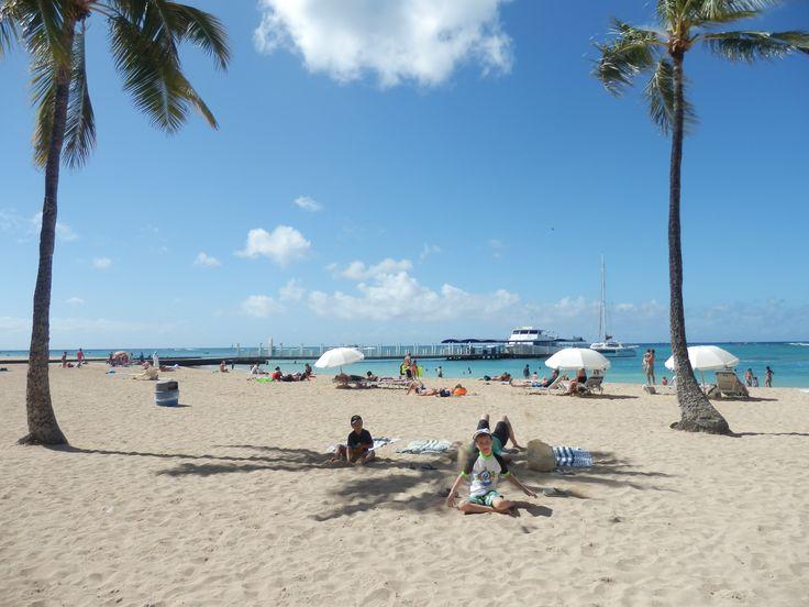 The beach in front of the Hilton Hawaiian Village in Honolulu, Hawaii, USA