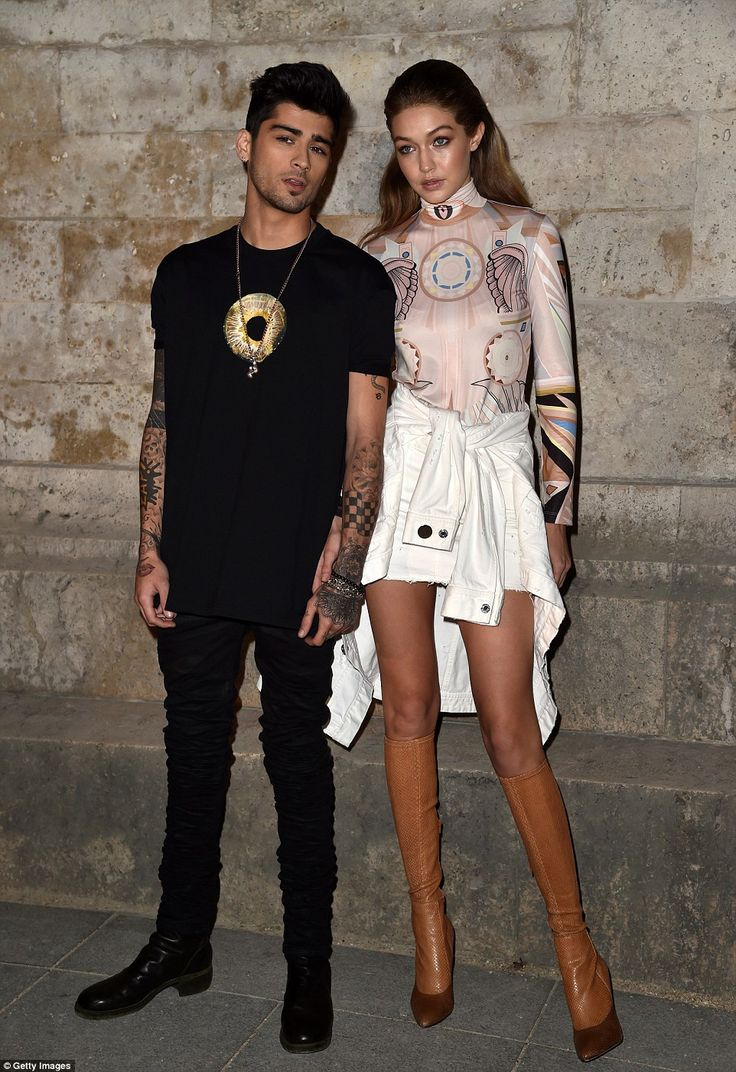 Finally off-duty: Gigi Hadid was not walking on the catwalk that evening, instead she sat in the audience with boyfriend Zayn Malik