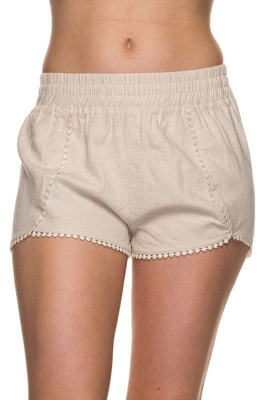 Such a classy, yet comfy option for woven shorts! Cute ivory pom pom detail with elastic waist. Poly Blend. made in the USA. Fit is true: Small 2/4, Medium 6/8, Large 10/12