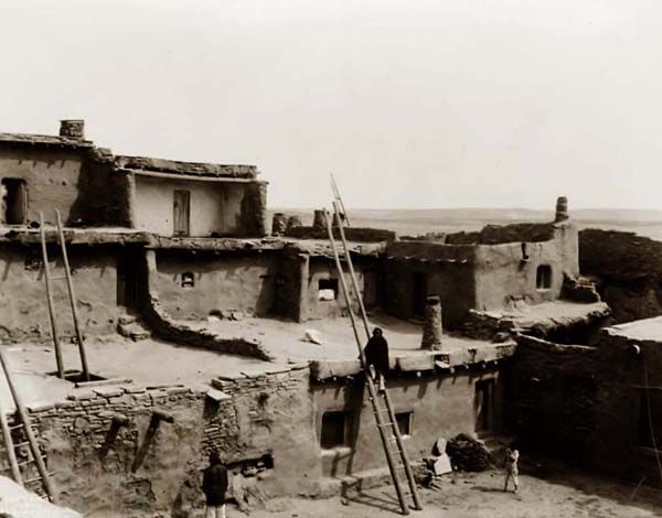 Zuni Pueblo You are viewing an impressive image of the Corner of a Zuni Pueblo. It was taken in 1903 by Edward S. Curtis. The image shows Adobe buildings and Indians. We have created this collection of pictures primarily to serve as an easy to access educational tool. Contact curator@old-picture.com. Image ID# 9BE59482