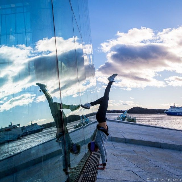 hand stand, yoga, with a mirror effect on the opera in Oslo :)
