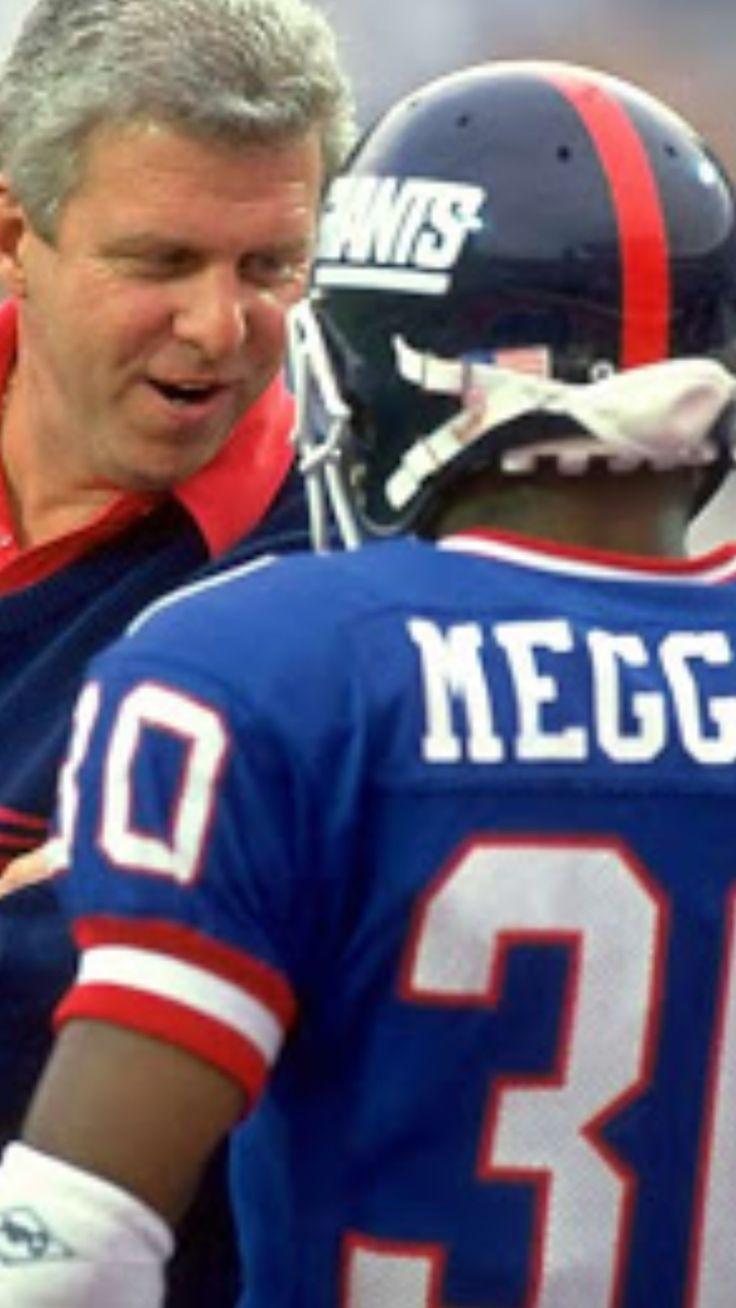 Head coach Bill Parcells teaching Specialist David Meggett the finer points of punt returning.