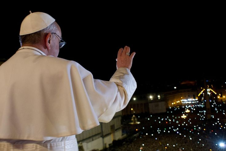 Pope Francis greets the expectant crowd in St. Peter's Square after his election. 13 March 2013