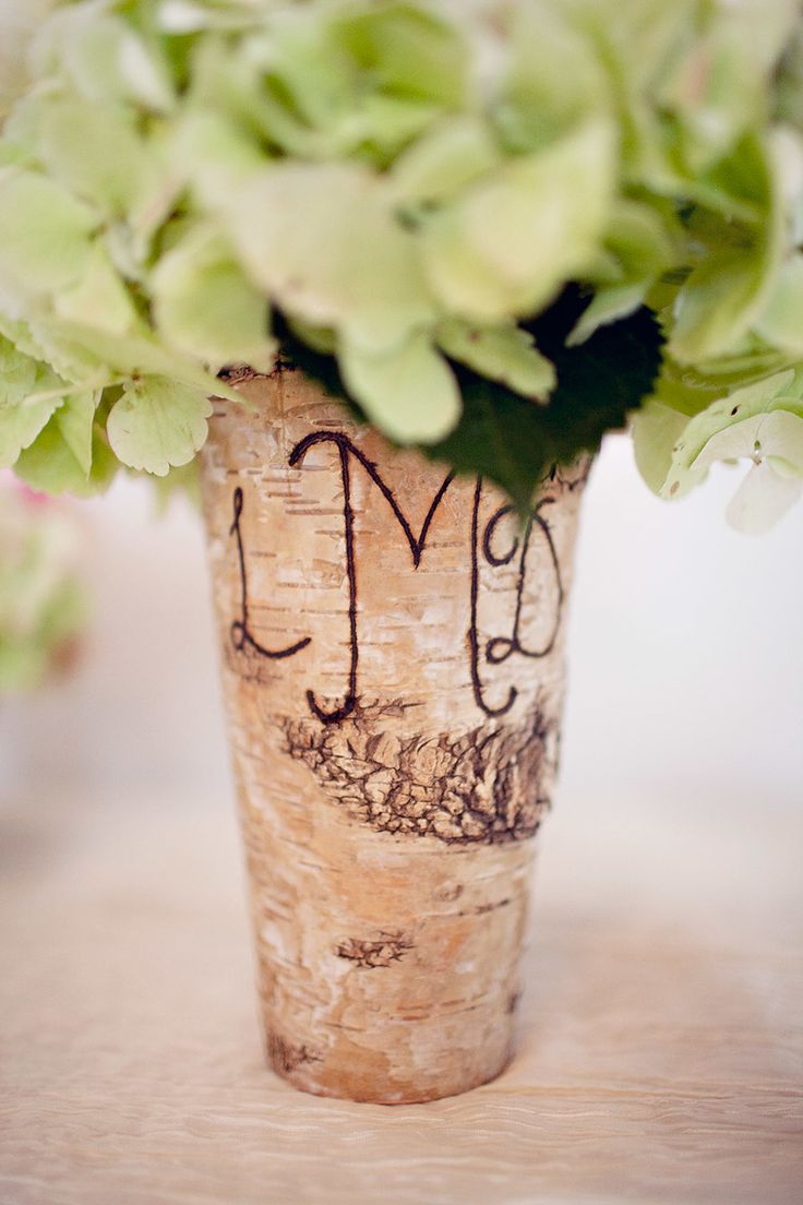 Wooden Vase with Carved Initials | See the wedding on SMP - http://www.StyleMePretty.com/little-black-book-blog/2014/01/09/whimsical-pastel-coral-gables-country-club-wedding/ Laura Leslie Photography