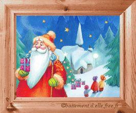 gif animé noel un village enneigé des enfants devant un sapin et le père noel qui arrive avec des présents
