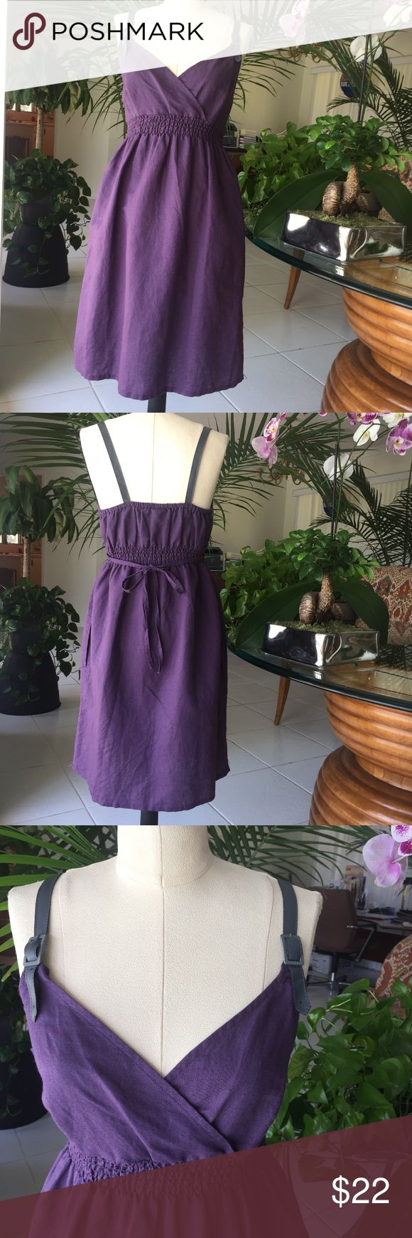 Converse purple midi dress Converse purple beach dress , the top has a crossover front , elasticized waist with self back tie , side hidden pockets , adjustable buckle leather like straps , 55% linen / 45% cotton blend , size M , new no tags , in perfect condition , comes from a non smoking home . Converse Dresses Midi
