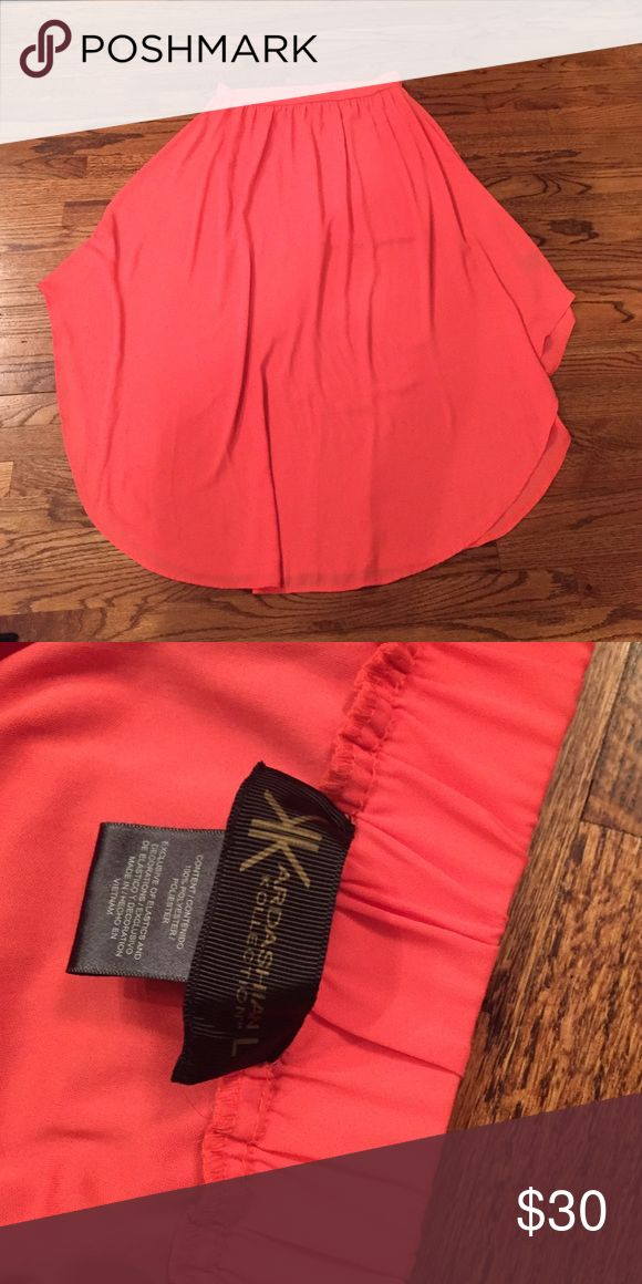 Kardashian collection coral maxi skirt This is a coral maxi skirt from the Kardashian collection. The skirt has a mini skirt underneath it and a slightly higher on the sides. It is a size large. Kardashian Kollection Skirts Maxi
