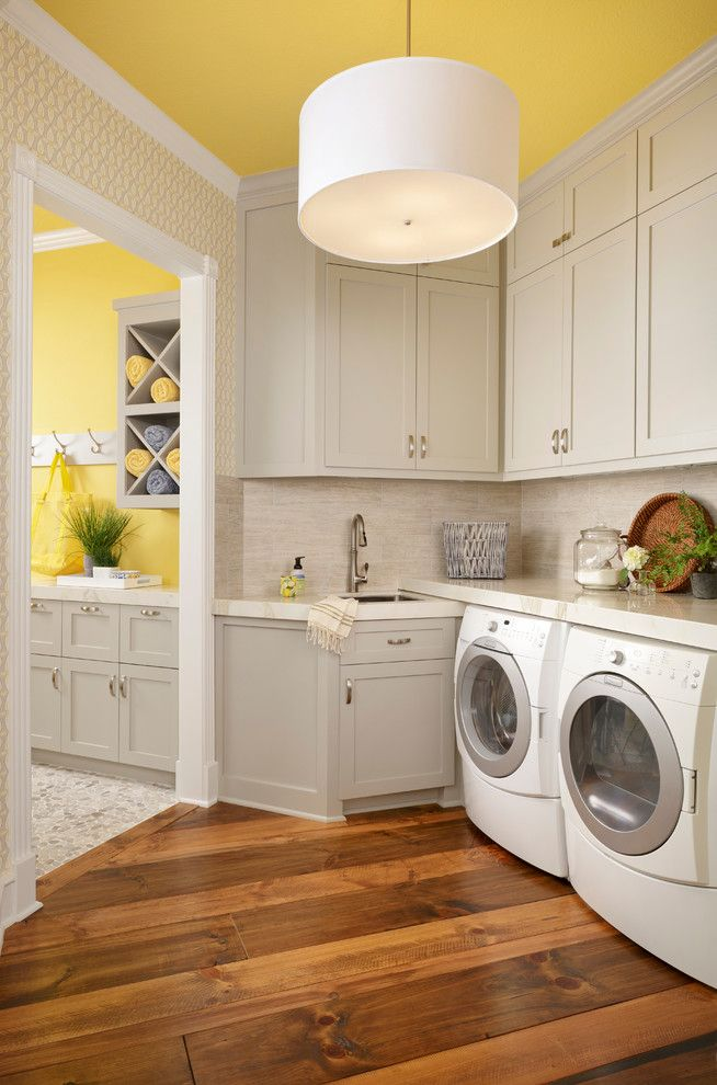 Bright laundry room, wood floor, yellow ceiling, white pendant lighting | Yates & Chairma Design Group