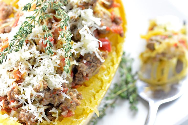 Hearty Spaghetti Squash Boats loaded with sausage, cheese and spices. All the flavor of traditional pasta without all the gluten and empty calories.