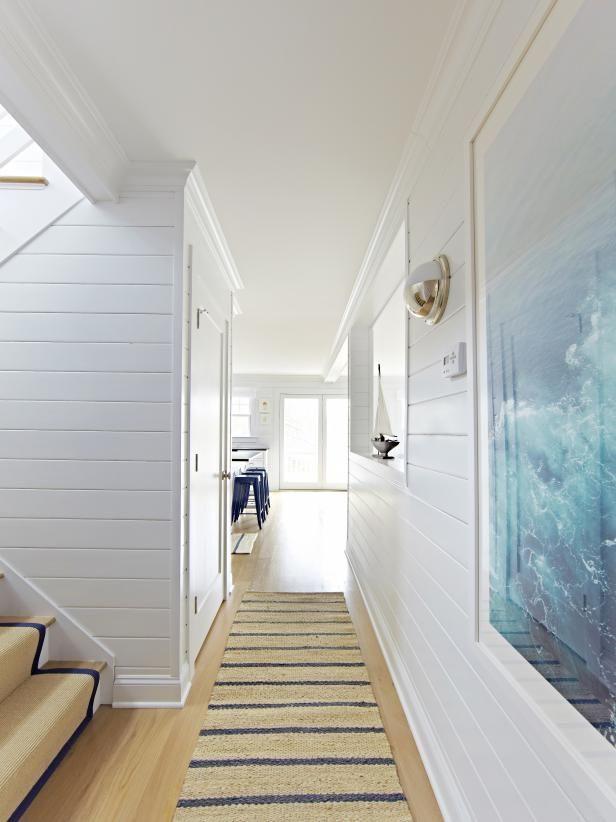 White Coastal Bungalow With Shiplap Walls and Nautical Theme