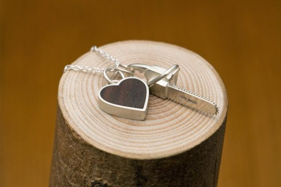 Wooden Heart and Chainsaw combo necklace. Perfect gift for the loggers loved one.
