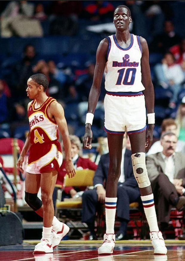 Manute Bol the tallest person to ever play in the NBA towering over 57 Spud Webb.