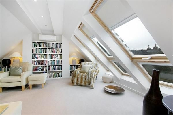 Attic conversion with sun windows and built in bookshelf
