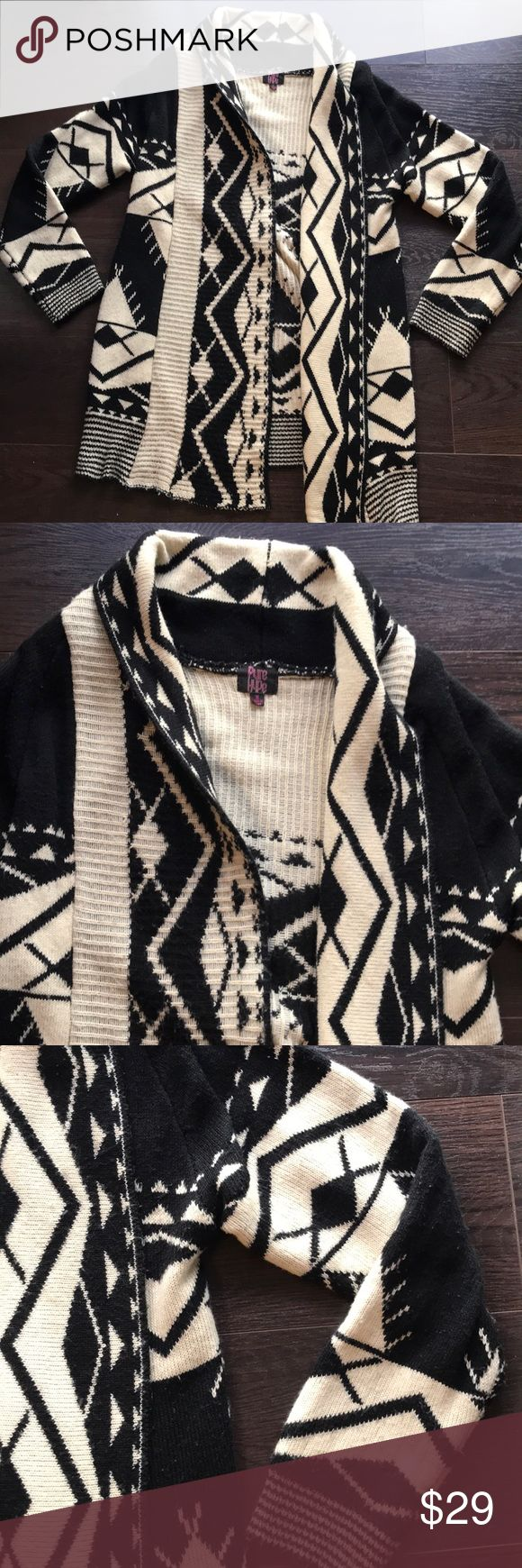 Pure Hype cozy tribal cardigan sweater - Medium Pure Hype cozy tribal cardigan sweater - Medium. Gently loved. Slight pilling but otherwise perfect. Fantastic for the office. Medium thickness. Warm and soft. Cream and black. Wear with skinny jeans and ugg boots.  ❤️Make an offer! Please remember Poshmark takes 20% Sorry no trades ❤️I ship quickly! Please accept your packages on the app as soon as you receive them so that the sellers can be paid.  ❤️Please read all descriptions and note…