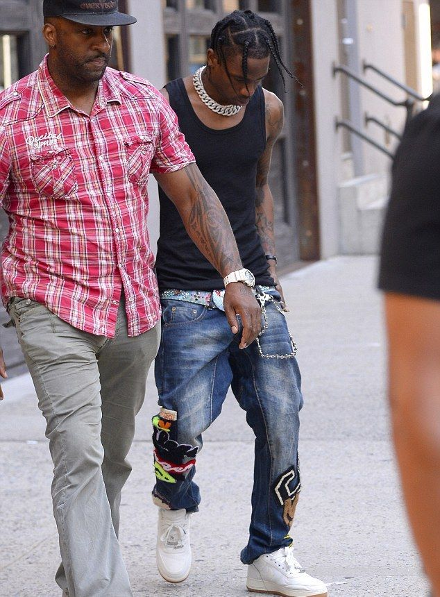 f3f7bec1603 Travis Scott Rocks Dsquared2 Jeans And Travis Scott X Nike AF1 Cactus Jack  Sneakers