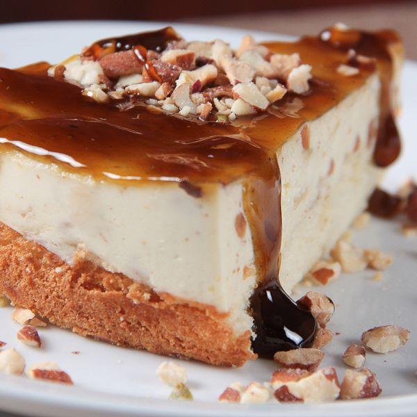 A classic cheesecake recipe topped with warm and sweet fudgy sauce.
