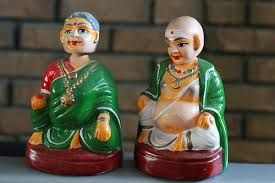 A tanjore doll is a type of traditional Indian bobblehead  toy made of terracotta material. Its centre of gravity and total weight is concentrated at its bottom-most central core all the time so as to present a dance-like continuous movement with slow-damping oscillations. Round-bottomed toys are unique[clarification needed], Traditionally these toys are handmade and their exteriors are painted to an intrinsic sense of humour.