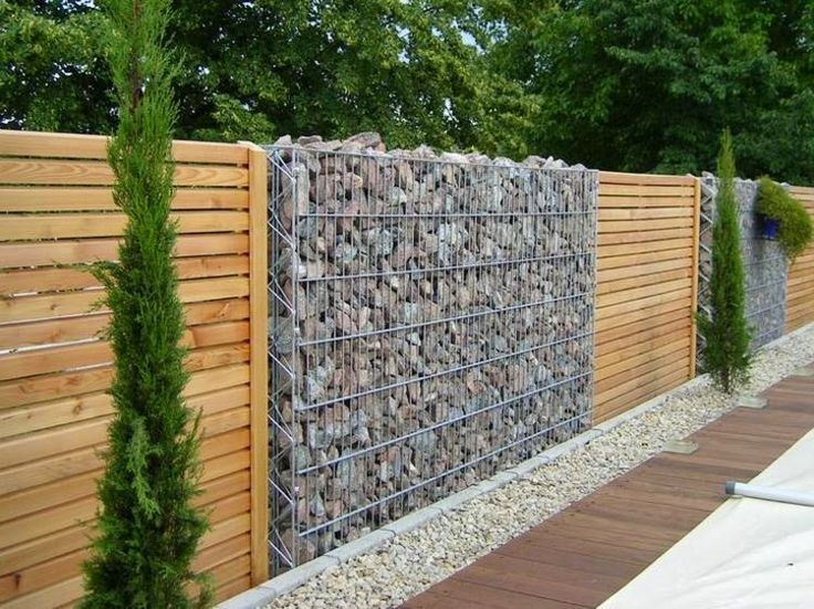 Idea for fence around front yard - I like featuring the rock and the wood. . . .