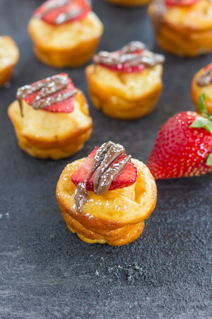 These Nutella Stuffed Pancake Bites are a quick and easy breakfast that's packed with flavor. A Greek yogurt pancake batter is filled with Nutella and then baked until fluffy and golden. No flipping or heating a griddle is required, as you can have these bites ready in no time!