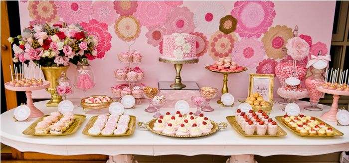 loving the gold accents. pink and gold dessert table with vintage doilies backdrop.