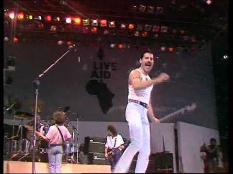 """Queen had a pretty tough task when they took the stage at Live Aid in July of 1985. Given 20 minutes, they did everything possible to cram a full concert into it. They opened with an abbreviated """"Bohemian Rhapsody"""" that went right into """"Radio Ga Ga."""" They played two more songs before the finale of """"We Will Rock You"""" into """"We Are the Champions."""" Many bands were swallowed up by the enormous Wembley stage, but Mercury worked it like an absolute pro."""
