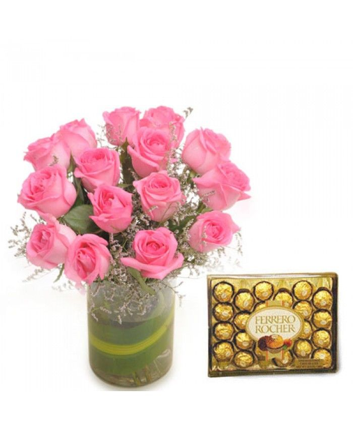 Bunch of 15 Pink roses in a glass vase, 300gm Ferrero rocher chocolate box. Price: Rs.1,499.00  Order now and gift to your MOM..