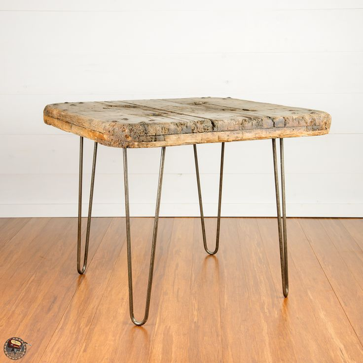 Salvaged industrial work dolly repurposed into a coffee table with custom hairpin legs.  Made by AM 823. Follow on instagram and Facebook @ameight23