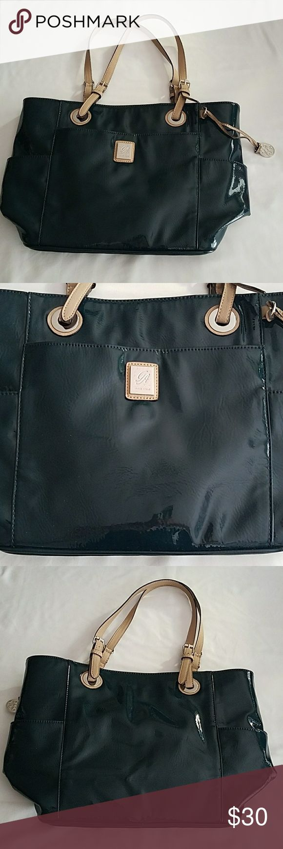 "Grace Adele purse Grace Adele purse. H 11"", L 16.5"", W 6"". In great condition. A very nice blue color . Has a front outside pocket, a pocket on each side of purse, and inside has 2 pockets with zipper, 2 pockets that close with a magnetic clip, a pen pocket and two more small pockets. Plus an extra clear plastic bag that you can use for your makeup. Very nice purse!!! Grace Adele Bags"
