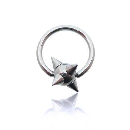 Piercing anneau avec une boule incrustée de pics. Tout le bijou est en acier chirurgical. #piercing #homme #teton