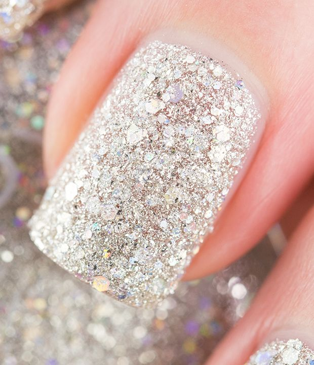 Up Close Shot of Zoya Magical Pixie Cosmo - textured, matte and sparkling with a holographic hex glitter via @Tiffany Martinez