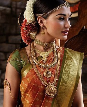 Gorgeous Orange and Green Silk Saree with Gold Jewelry