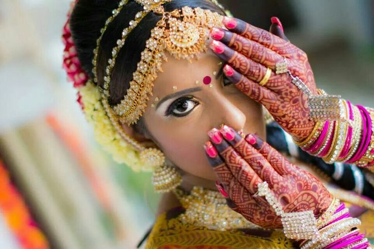 A traditional bride pose but hiding her nosepins BEAUTIFUL